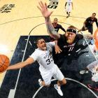 Boris Diaw of the San Antonio Spurs drives to the hoop as Chris Andersen of the Miami Heat reaches for the block. Diaw finished the contest with 16 points -- his third consecutive game scoring double-digits -- and helped the Spurs claim a 111-87 victory.