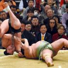 Mongolian yokozuna Harumafuji (left), whose real name -- for those of you keeping score at home -- is Altangadasyn Khuchitbaatar, tossed down with Toyonoshima and came up victorious on Day One of the Grand Sumo Spring Tournament at Body Maker Colosseum in Osaka, Japan.