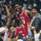 Lorenzo Charles began the season in coach Jim Valvano's doghouse for stealing two pizzas, but the sophomore forward finished on top of the world, after his buzzer-beating dunk defeated Houston 54-52. In upsetting the top-seeded Cougars, the Wolfpack became the first 10-loss team to win a title.
