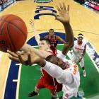 Baye-Moussa Keita of Syracuse drives to the hoop as Jordan Vandenberg of N.C. State defends during a Friday quarterfinal game of the 2014 ACC Tournament. The Wolfpack claimed a 66-63 upset over the Orange, giving Syracuse its fifth loss in seven games.