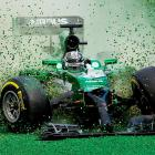Japanese driver Kamui Kobayashi gets off the track after crashing into Brazilian driver Felipe Massa during the Australian Formula One Grand Prix on Sunday. German Nico Rosberg won the race.