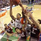 Miami's Rion Brown drives to the basket over Virginia Tech's Trevor Thompson during an ACC Tournament first-round game. Miami won 57-53, sending Virginia Tech to its seventh straight loss and its 17th defeat in 18 games.