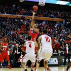 <italics>SI's best photographs from Thursday's games in the NCAA tournament.</italics> Vee Sanford was the hero of the day for Dayton, hitting this shot in the closing seconds to lift the Flyers over Ohio State. <bold>SI Video: Dayton knocks off Ohio State </bold>