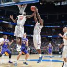 Dorian Finney-Smith (10) and Patric Young helped Florida move on to face Pittsburgh on Saturday.