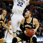 JayVaughn Pinkston tries to keep from fouling after getting caught in the air on a block attempt.