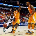 Chaz Williams tries to work inside against Tennessee. The Minutemen trailed by 20 before the half.