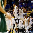 Cleanthony Early and Nick Wiggins celebrate a play; Wichita State faces Kentucky on Sunday.