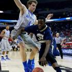Isaiah Armwood, being defended here by Austin Nichols, led GW with 21 points.