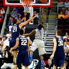 Despite his team having lost three of its previous five games, Joe Jackson guaranteed Memphis would win its first two NCAA tourament games. He's halfway to being right after chipping in with 15 points.