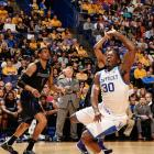 Julius Randle (30) had 19 points and 15 rebounds as Kentucky advanced to a coveted Sunday date with unbeaten Wichita State.