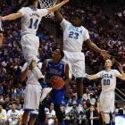 Rashad Smith tries to time his jump as Zach LaVine and Tony Parker defend.
