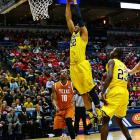 Jordan Morgan goes strong to the basket for two of his 15 points. The second-seeded Wolverines will face the winner of Sunday's Mercer-Tennessee game.
