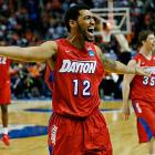 <italics>SI's best shots from Saturday's games of the NCAA Tournament</italics>, on a day when Jalen Robinson and Dayton crashed the Sweet 16 by defeating Syracuse.