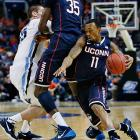 Ryan Boatright goes behind a screen set by Amida Brimah during UConn's win over second-seeded Villanova.