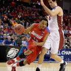 Vee Sanford drives past Stefan Nastic, who fouled out with five minutes still to go.