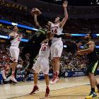 Frank Kaminsky, pictured here stopping a Gary Franklin shot, had six blocks in helping Wisconsin reach the Elite Eight for the third time in school history.