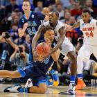 Kyle Anderson (5) and Dorian Finney-Smith battle to get control of the ball. UCLA couldn't match Florida's physical defense or outshoot the Gators.