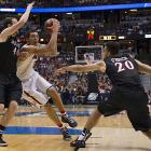 Aaron Gordon drives against Matt Shrigley. Gordon and Nick Johnson led the Wildcats with 15 points each.