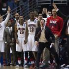 The Arizona bench celebrates a play. Next up for the top-seeded Wildcats -- second-seed Wisconsin.