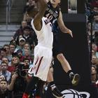 Matt Shrigley gets all ball on a Rondae Hollis-Jefferson shot. The Aztecs led by eight points early in the second half after leading by that many just before halftime.