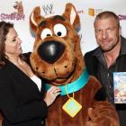 """WWE's Chief Brand Officer collars SI.com's own Scooby Axson at the gala premiere of<italics> Scooby Doo! WrestleMania Mystery</italics> in New York City's Tribeca Cinemas. The animated flick featuring Triple H (the smirking gent on the right) and others of his ilk is being hailed as """"a poignant look at the contemporary social scene"""" by people who haven't actually seen it, but would surely like you to believe otherwise."""