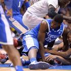 Alex Poythress (22) goes after loose ball. He had a huge block in the closing minutes and then scored off an offensive rebound on the subsequent possession to help spark the Wildcats.