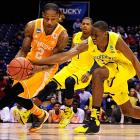 Caris LeVert tries to steal the ball from Antonio Barton.