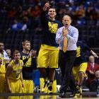 Michigan coach John Beilein urges on his team.