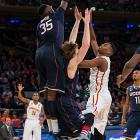 Amida Brimah (35) goes high to try to block a shot.
