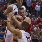 Wisconsin's Josh Gasser is sandwiched by Nick Johnson and Kaleb Tarczewski.