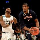 DeAndre Daniels (2) finished with eight points and 12 rebounds. More importantly, he shut down Branden Dawson, who scored 24 points in Michigan State's Sweet 16 win over top-seeded Virginia. Dawson attempted just three field goals, making one, to finish with five points.
