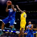 Julius Randle and Kentucky are the first all-freshman starting lineup to make the Final Four since the Fab Five of Michigan did it in 1992. Randle had 16 points and 11 rebounds for his 24th double-double and was named the region's most outstanding player.