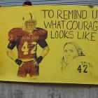 Students and fans display a poster honoring Tillman at the final home game of the Sun Devil's 2004 season. Tillman's number was retired during a halftime ceremony on the same day.