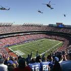 Helicopters fly over Giants Stadium in honor of Tillman before the start of a September 2004 game between the New York Giants and Washington Redskins.