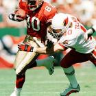 Tillman tackles San Francisco 49ers wide receiver Jerry Rice in an October 2000 game.
