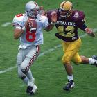 Tillman chases down Ohio State quarterback Stanley Jackson during the Rose Bowl in 1997.