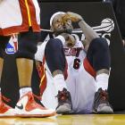 The King on his court after being elbowed in the schnozz by Charlotte's Josh McRoberts during Game 2 of their playoff series in Miami. After quick action by alert medical staff, James was outfitted with a new proboscis and the Heat went on to beat the Bobcats 101-97.