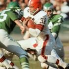 Jim Brown takes off against the Philadelphia Eagles. He won the seventh of his eight rushing titles in 1964.