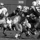 Morrall quarterbacks Detroit in a game against the Baltimore Colts. In his 21 NFL seasons, he also played for the 49ers, Steelers and Giants, winning three Super Bowl rings.