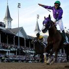 SI's best photos from the 140th Kentucky Derby, where favorite California Chrome and jockey Victor Espinoza dominated the 1¼ miles in a time of 2:03.66.
