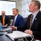 "Denver Broncos head coach John Fox, left, John Elway, center, executive vice president of football operations, and general manager Brian Xanders sit in the team's ""war room"" in 2011. The Broncos selected Texas A&M linebacker Von Miller as their first-round pick, the second overall pick."