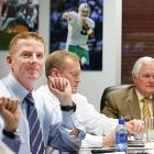 Dallas Cowboys offensive coordinator Jason Garrett, left, Jerry Jones Jr., center, chief sales & marketing officer, and Cowboys coach Wade Phillips look on in the war room during the first round of the NFL Draft at Valley Ranch in Irving, Texas, Thursday, April 22, 2010.