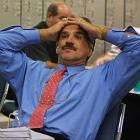Miami Dolphins head coach Dave Wannstedt reacts while waiting for the beginning of the NFL draft to start in 2001.