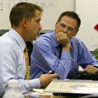 New Orleans Saints general manager Mickey Loomis has discussion with head coach Sean Payton about drafting Reggie Bush of USC with the number 2 pick in the 2006 NFL Draft.