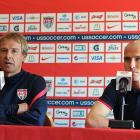 U.S. midfielder Michael Bradley (right) and Klinsmann address the media in 2012. Klinsmann replaced Bradley's father, Bob, as U.S. coach in 2011, intending to create a distinctly American style of play.