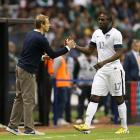 Forward Jozy Altidore is greeted by Klinsmann after being substituted in a 1-1 World Cup qualifier draw with Mexico in Mexico City.