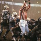 Buffalo Bills quarterback and future Congressman Jack Kemp (15) falls in for an insurance touchdown during a 20-7 win in the AFL Championship Game against the San Diego Chargers at War Memorial Stadium.