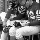 Baltimore Colts Jim Welch (right) and Ted Davis casually browse through <italics>Playboy</italics> before practice at Memorial Stadium.