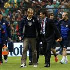 Klinsmann and Mexico head coach Jose Manuel de la Torre chat before the game at Estadio Azteca in Mexico City.