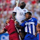 Jozy Altidore rises over Honduras goalkeeper Noel Valladares (18) and defender Jose Velasquez (5) on a corner. Altidore would score in the 73rd minute for a 1-0 U.S. win, June 18, 2013, in Sandy, Utah.